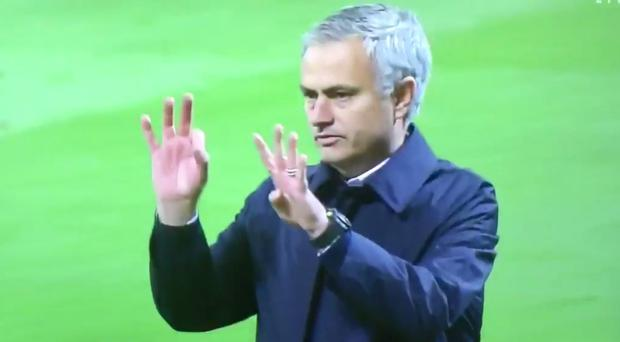 Jose Mourinho gestures to the Manchester United fans