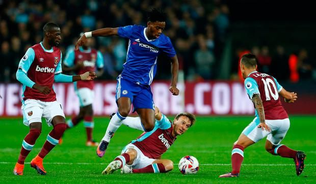 Chelsea's Nathaniel Chalobah is quickly surrounded and dispossessed. Reuters / Eddie Keogh