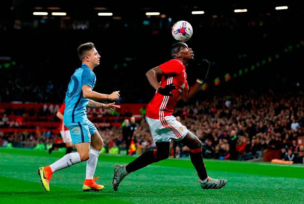 Paul Pogba controls the ball with his head as he is closed down by Pablo Maffeo. Photo: Martin Rickett/PA Wire