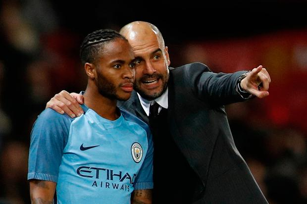 Pep Guardiola gives instructions to Raheem Sterling. Reuters / Darren Staples