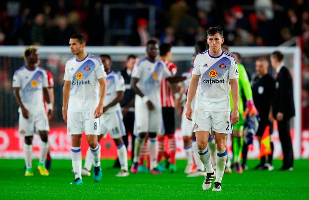 Sunderland's Billy Jones (right) looks dejected after the final whistle. Photo: Andrew Matthews/PA Wire