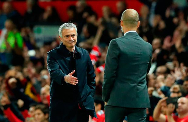 Manchester United manager Jose Mourinho (left) and Manchester City manager Pep Guardiola shake hands after the EFL Cup