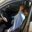 Erika Hurt sits with her baby in the back seat of the car in Hope, Ind. Police said she appeared unresponsive from an overdose and had a syringe in her hand CREDIT: TOWN OF HOPE POLICE DEPARTMENT