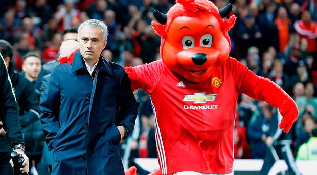 Manchester United manager Jose Mourinho with mascot Fred The Red