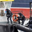 Members of The ERU Garda Support Unit and The Garda Water Unit pictured in action boarding a suspect Vessel during The Garda Emergency Training Exercise at Drogheda Port, Co. Louth this morning. PIC COLIN O'RIORDAN
