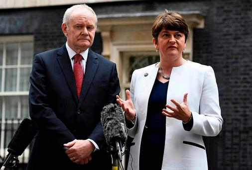 Arlene Foster (R) and Martin McGuinness, First and Deputy First Ministers of Northern Ireland, speak to journalists as they leave Number 10 Downing Street. Photo: REUTERS/Dylan Martinez