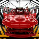 Staff inspect the finish on a Qashqai model in the paint shop at Nissan's plant in Sunderland. Photo: AFP/Getty Images