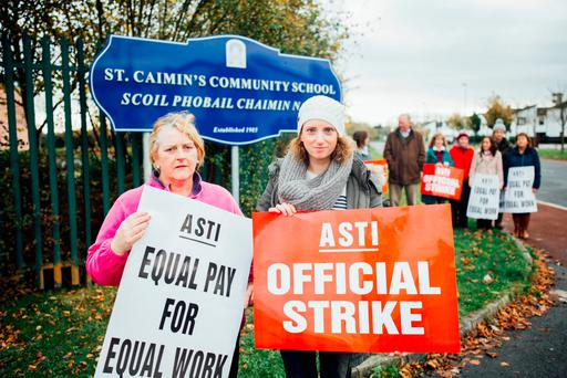 Teachers Bernadette Dalton and Niamh McDonnell on strike outside St Caimin's Community School in Shannon, Co Clare. Photo: Brian Arthur
