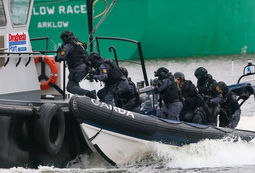 Members of the Garda Emergency Response Unit pictured boarding a vessel this morning at Drogheda Port during a two part excercise. Picture Colin Keegan, Collins Dublin.