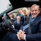 Enda Kenny with Mary Mitchell O'Connor yesterday at the announcement of Cubic Telecom's creation of 60 jobs at its Dublin office. Photo: Andres Poveda
