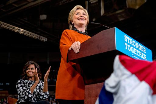 Democratic presidential candidate Hillary Clinton, accompanied by First Lady Michelle Obama, left, speaks at a rally at Wake Forest University in Winston-Salem, North Carolina, Thursday, Oct. 27, 2016. (AP Photo/Andrew Harnik)