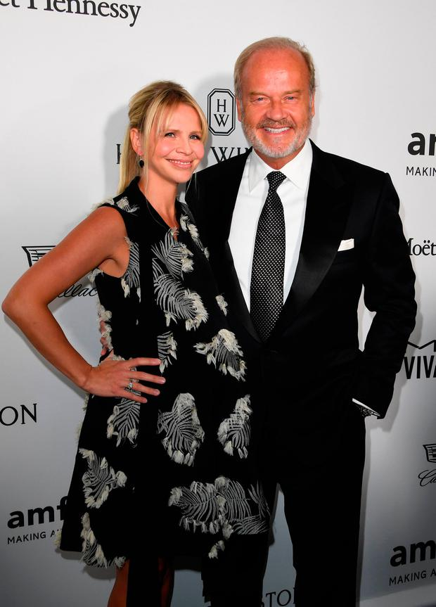 Actor Kelsey Grammer (R) and Kayte Walsh arrive for amfAR's Inspiration Gala Los Angeles at Milk Studios in Hollywood, California