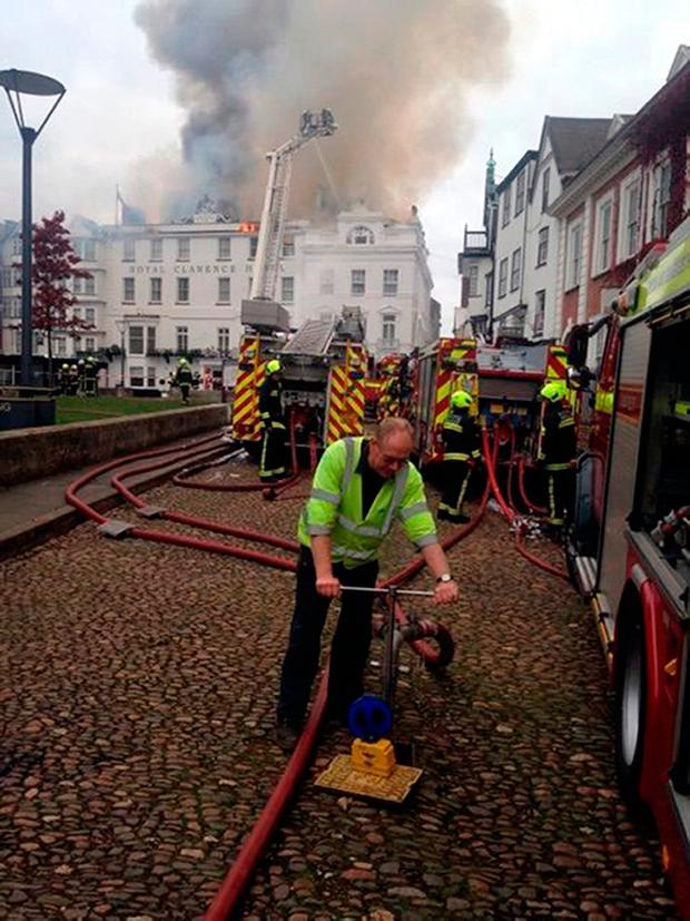 Devon & Somerset Fire & Rescue Service handout photo of firefighters tackling a blaze at Royal Clarence Hotel in Exeter Credit: Devon & Somerset Fire & Rescue Service/PA Wire