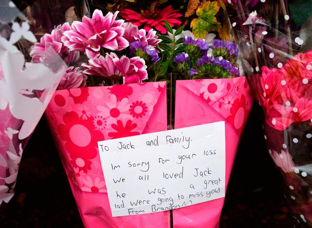Flowers tributes at the scene in Byron Avenue in Campsall, South Yorkshire, where the body believed to be that of a 13-year-old boy has been found following a fire in a shed Credit: Anna Gowthorpe/PA Wire
