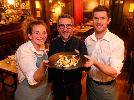 Manager Conor Kavanagh, centre, with waiters Jennifer Loane and Dave Kerr in the Old Spot Photo: Damien Eagers
