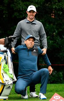 Rory McIlroy drags Sergio Garcia to his feet yesterday. Picture: Getty Images
