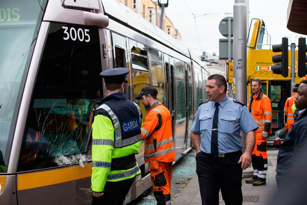 Emergency services at the scene after a tour bus and a Luas tram crashed in Dublin yesterday Photo: Mark Condren