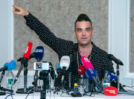 Robbie Williams at the Intercontinental Hotel in Dublin, where he announced he will perform at the Aviva stadium next June Photo: Kyran O'Brien