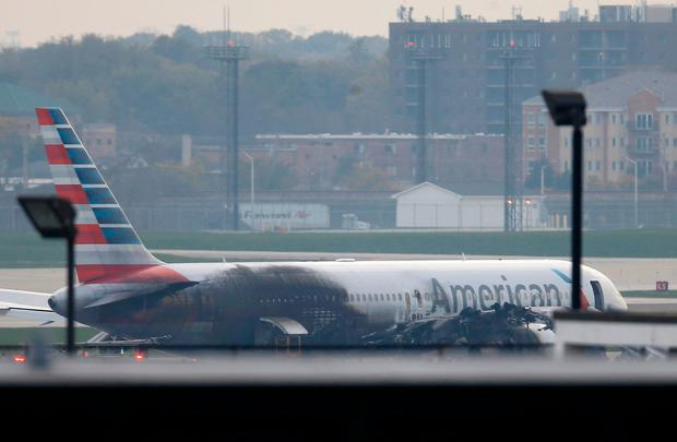 Soot covers the fuselage of an American Airlines jet that blew a tire, sparking a fire and prompting the pilot to abort takeoff before passengers were evacuated from the plane via emergency chute, at O'Hare International Airport in Chicago, Illinois, U.S.October 28, 2016. REUTERS/Jim Young