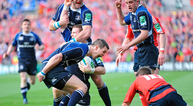 Leinster's Jonathan Sexton celebrates in front of Munster's Ronan O'Gara in 2009