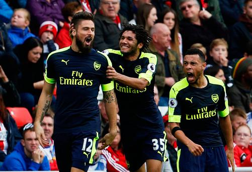 Arsenal's Olivier Giroud celebrates scoring their second goal with Francis Coquelin and Mohamed Elneny