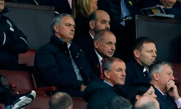 Manchester United manager Jose Mourinho looks on from the crowd after being sent to the stands
