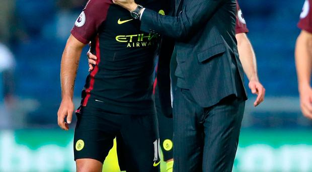 Manchester City manager Pep Guardiola (right) and Manchester City's Sergio Aguero celebrate after the final whistle