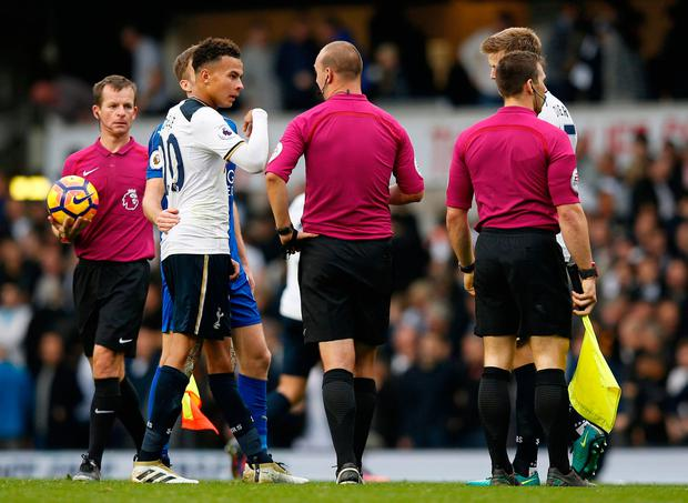 Tottenham's Dele Alli speaks to referee Robert Madley