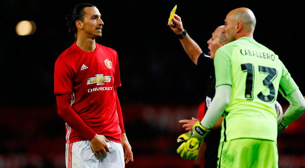 Manchester United's Zlatan Ibrahimovic is booked by referee Mike Dean