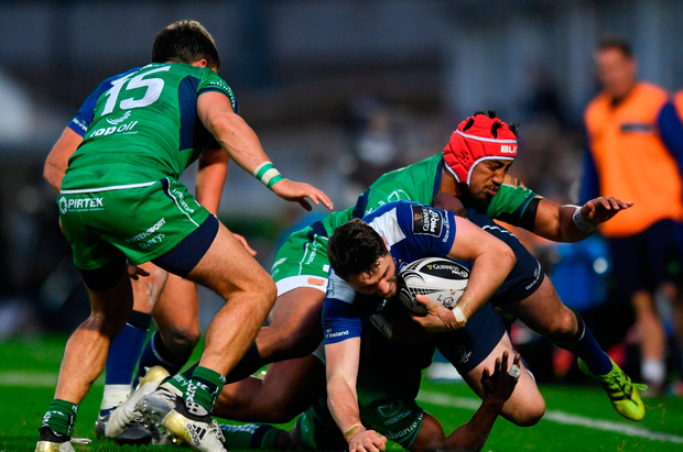 Barry Daly of Leinster is tackled by Bundee Aki of Connacht