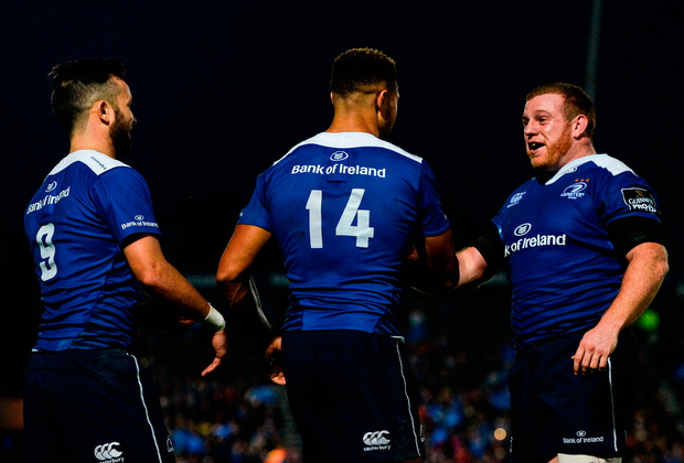 Adam Byrne, centre, of Leinster, is congratulated by teammates Jamison Gibson-Park, left, and Sean Cronin