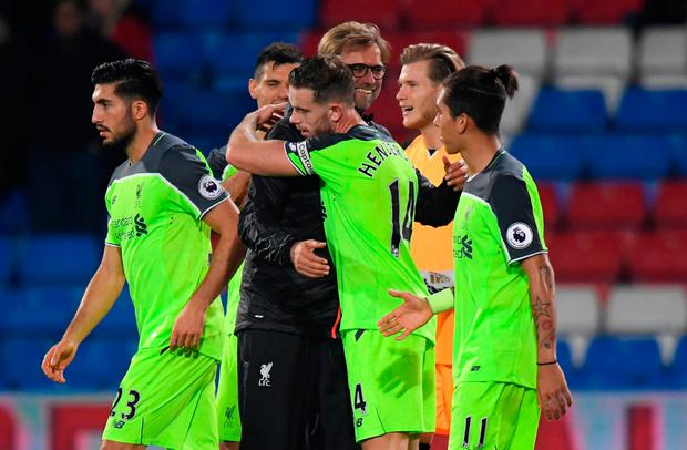 Liverpool manager Juergen Klopp with Liverpool's Jordan Henderson after the match