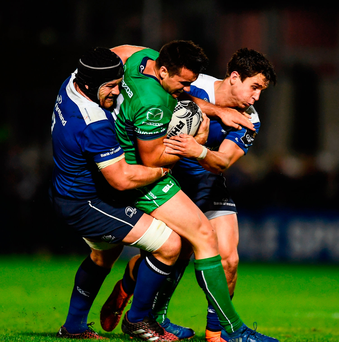 Cian Kelleher of Connacht is tackled by Sean O'Brien, left, and Joey Carbery of Leinster