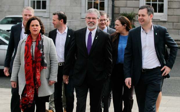 Protestations of progress: Sinn Fein president Gerry Adams with vice-president Mary Lou McDonald and other party members. Despite all Sinn Fein's claims that the party has moved on, it is still guilty of a backwards-looking mindset Photo: Stephen Collins/Collins Photos