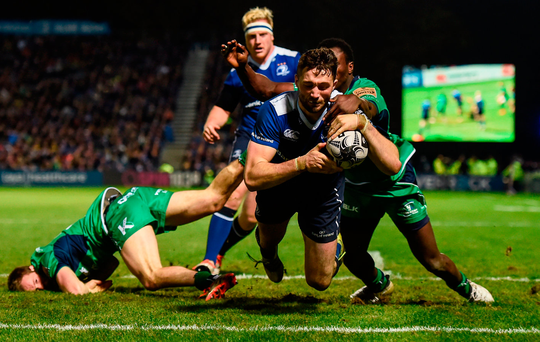 Leinster's Barry Daly scores his side's second try despite the tackle of Niyi Adeolokun during the Guinness PRO12 clash at the RDS. Photo: Stephen McCarthy
