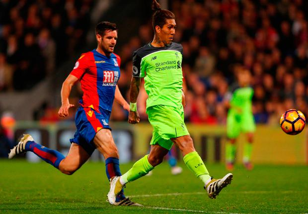 Roberto Firmino of Liverpool scores his team's fourth goal. Photo by Ian Walton/Getty Images