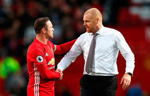 Wayne Rooney of Manchester United and Sean Dyche, Manager of Burnley had a friendly chat after the game. Photo: Getty