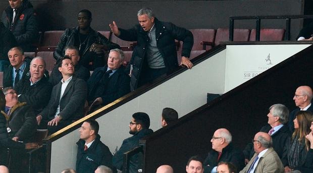 Manchester United's Portuguese manager Jose Mourinho (top C) gestures and shouts in the Directors Box after being sent off. Photo: AFP
