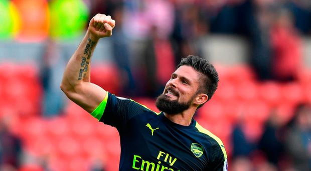 Olivier Giroud of Arsenal celebrates his team's 4-1 win. (Stu Forster/Getty Images)