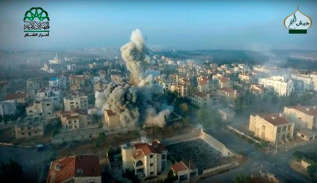 This still image taken from drone footage, posted online by the communications arm of Ahrar al-Sham militant group (Ahrar al-Sham, militant video, via AP)