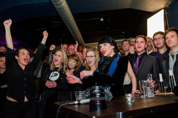 Birgitta Jonsdottir of the Pirate Party reacts alongisde party members after early results of the parliamentary elections in Iceland, October 29, 2016. Picture taken October 29, 2016. REUTERS/Geirix