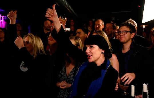 Birgitta Jonsdottir of the Pirate party (Pirater) reacts after the first results in Reykjavik, Iceland, Saturday, Oct. 29, 2016. (AP Photo/Frank Augstein)
