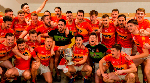 Castlebar Mitchels players celebrate with the MocClair Cup after the Mayo Senior Club Football Championship Final match between Castlebar Mitchels and Knockmore