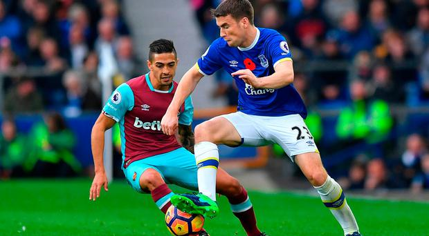 West Ham United's Manuel Lanzani (left) and Everton's Seamus Coleman
