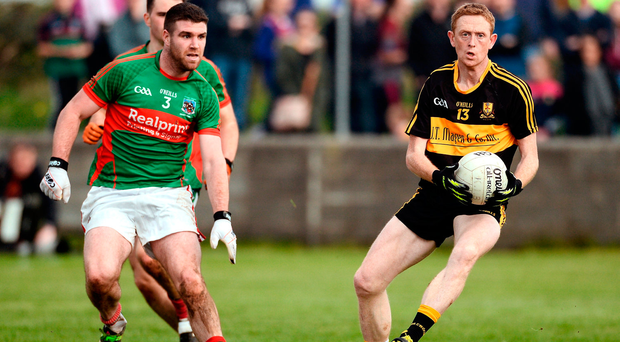 Colm Cooper of Dr Crokes in action against Darren Hickey of Kilmurry Ibrickane