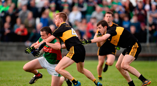 Peter O'Dwyer of Kilmurry Ibrickane in action against Fionn Fitzgerald and Michael Moloney of Dr Crokes