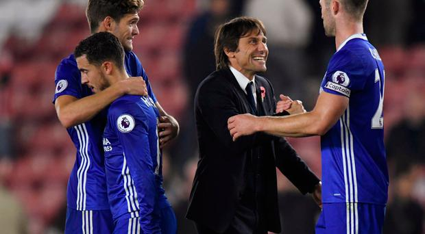 Chelsea manager Antonio Conte celebrates after the game with Gary Cahill, Edne Hazard and Marcos Alonso