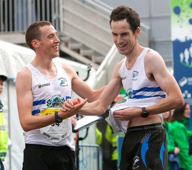 Martin Hoare, left, and Barry Murphy, from Celbridge Athletics Club, Co Kildare, celebrate after finishing yesterday. Photo: Damien Eagers
