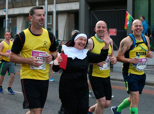 A runner dressed as a nun is all smiles. Photo: Damien Eagers
