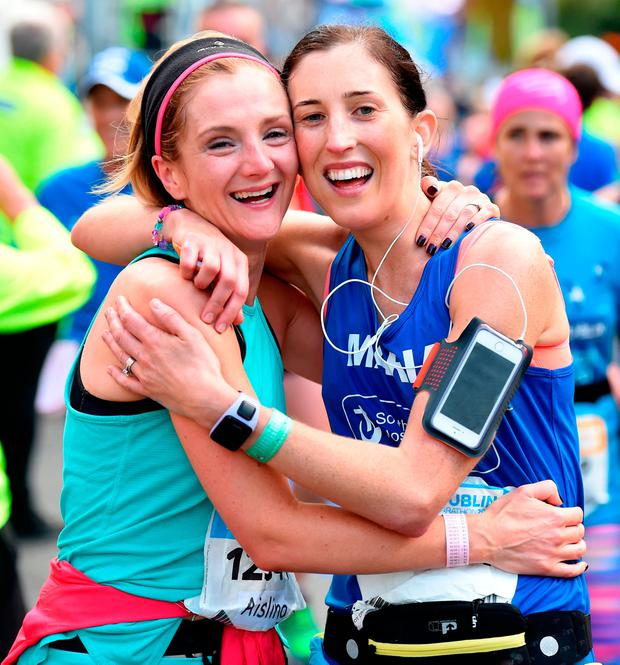 Aishling Green, left, and Maria Gray, celebrate after completing the SSE Airtricity Dublin Marathon 2016. A record 19,500 runners took part. Photo: Stephen McCarthy